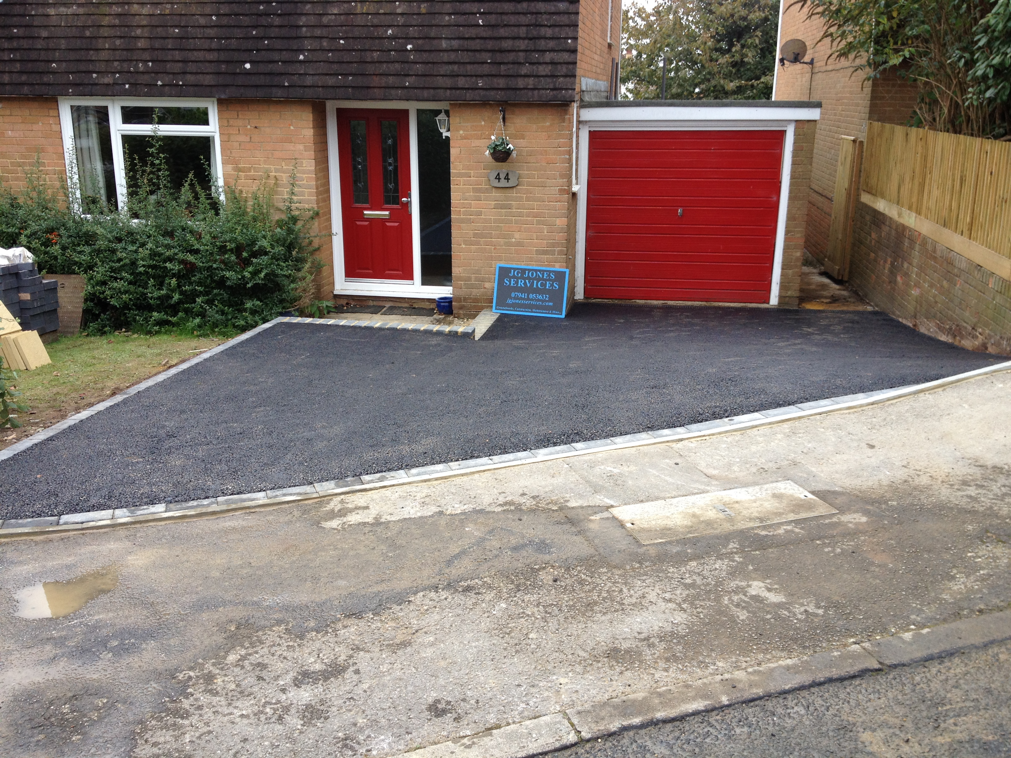 Sloped residential driveway j g jones groundwork services for Sloped driveway options